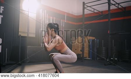 Sporty Asian Woman Exercise Doing Squat Body Weight Training Building Muscles And Burning Fat Cardio
