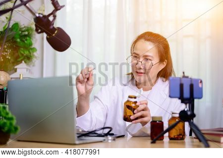 Asian Doctor Woman Online Working At Home. Recording Blog Video For Taking Medicine And Health Care.