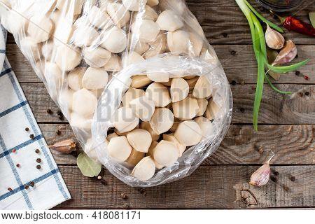 Traditional Russian Handmade Dumplings Frozen In A Plastic Bag. Russian Pelmeni. Ravioli