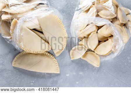 Raw Dumplings On Grey Table. The Process Of Making Dumplings. Traditional Homemade Food. Slavic Trad