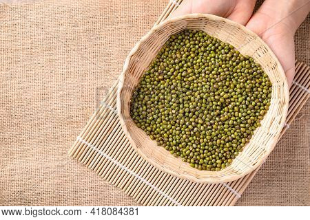 Mung Bean Seeds In Bamboo Basket Holding By Hand, Food Ingredients In Asian Cuisine And Produce Mung