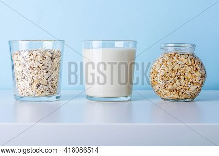 Glass Of Oat Flake, Vegetable Milk And Jar With Soaking Oatmeal. Concept Of Making Plant Based Organ
