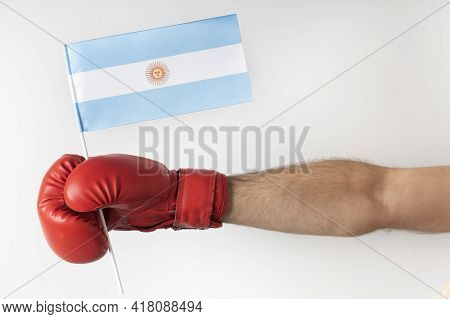 Boxing Glove With Argentina Flag. Boxer Holds Flag Of Argentina . White Background.