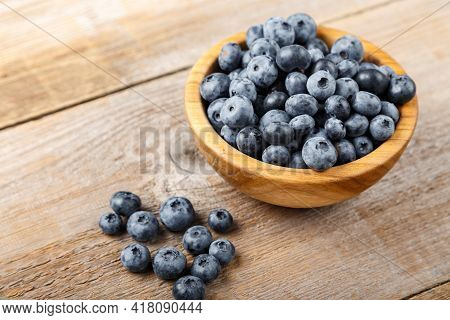 Fresh Blueberries In A Wooden Bowl. Healthy And Dietary Food Concept. Blueberry Is An Antioxidant.