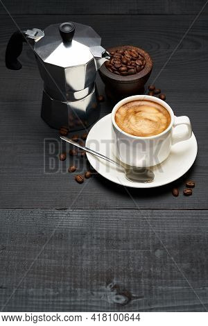 Cup Of Espresso Coffee And Mocha Coffee Maker On Dark Wooden Background
