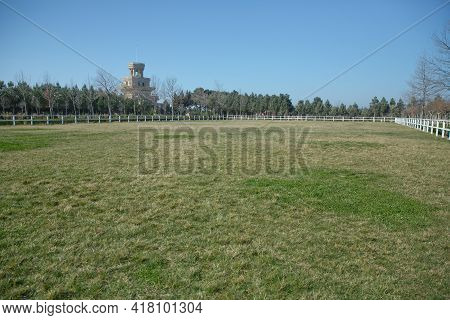 A White Fence With Green Gardens . Horse Racecourse Field . Large Farmland And Ranch Protection Back