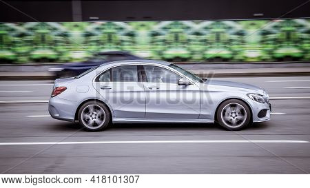 Moscow, Russia - April 2021: A Woman Drives Mercedes C-class At High Speed. A Silver Sedan Car Drive