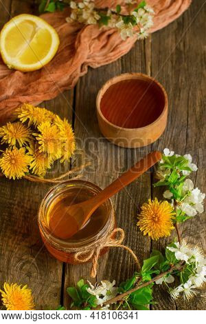 Homemade Delicious Flower Honey On A Light Wooden Table With Yellow Dandelions. Dandelion Flower Syr