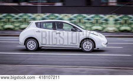 Moscow, Russia - April 2021: Nissan Leaf Electric Vehicle With Zero Emission Drives Fast Through The