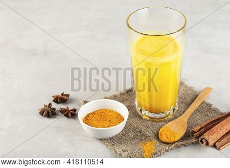 Ingredients For Golden Milk. Turmeric Powder, Curcuma Root, Badian Over Grey Background, Spices For