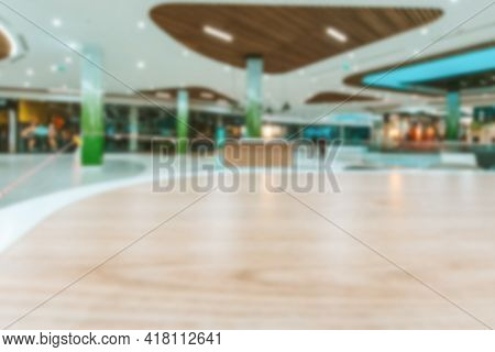 Mall People Blurred Background. Interior Of Retail Centre Store In Soft Focus. People Shopping In Mo