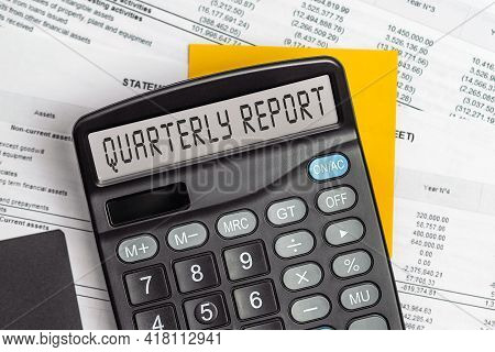 Quarterly Report . On Display Of Calculator Is Written Quarterly Report
