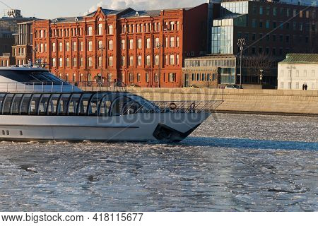 Yacht On The Moscow River In Winter. Urban Landscape Frozen River. The Yacht On The Moscow River In
