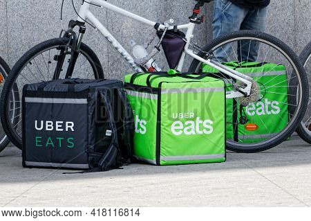 Warsaw, Poland - June 16, 2018: View On Uber Eats Bags Leaving On The Street And Bikes