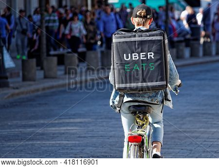 Warsaw/poland - April 22, 2018: Food Supplier With Uber Eats Backpack Riding A Bike On The Street