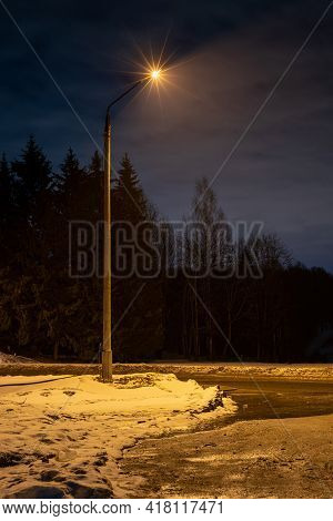 Evening Lonely Lantern. Evening Street Background. Night Street Winter Landscape.