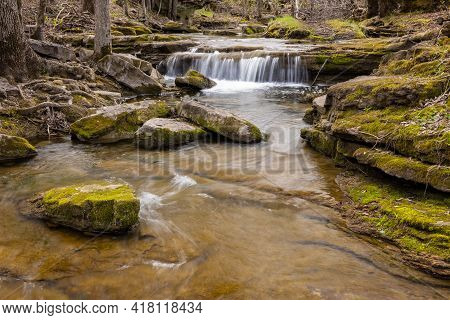 A Waterfall In The Woods During Spring.