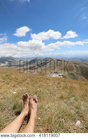 Feet Of A Hiker While Resting After The Long Walk In The Apennine Mountains In Central Italy In Summ