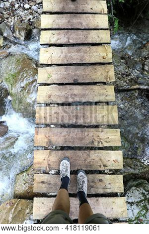 Dizzying Boardwalk For Wading The River And The Intrepid Hiker Walking Above