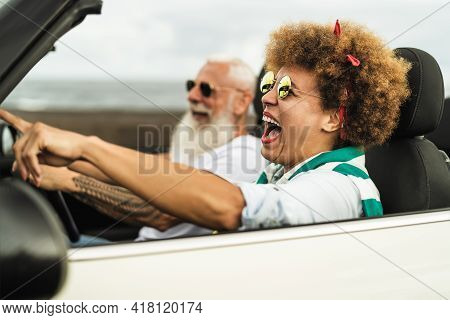 Happy Senior Couple Having Fun Driving On New Convertible Car - Mature People Enjoying Time Together
