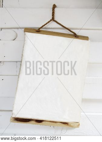 Empty Rustic Notepad Hanging On White Wooden Sheets. Close Up Of Notebook To Write Your Own Message