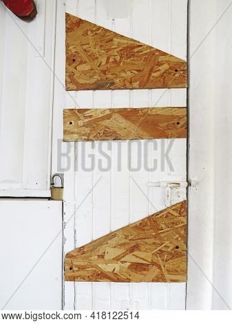 White Laminated Wooden Door With Cork Patches, Deadbolt And Padlock. Rustic Old White Wood Panel. Fr