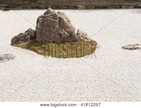 Zen Rock Garden in Ryoanji Temple.In a garden there are fifteen stones on white gravel. Kyoto.Japan.
