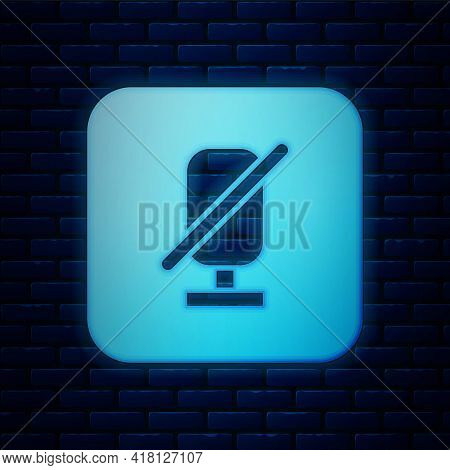 Glowing Neon Mute Microphone Icon Isolated On Brick Wall Background. Microphone Audio Muted. Vector