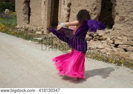 Woman Dance Belly Oriental Dancing In Coloured Costume Outdoor. Dance In The Street