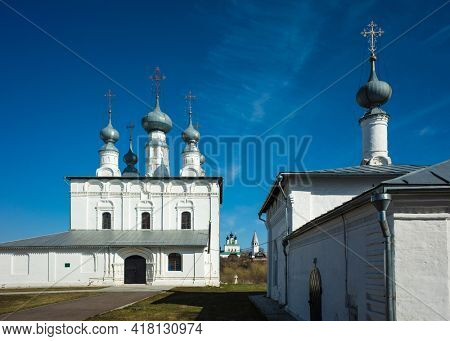 White russian churches, Peter and Paul Church and Church of St. Nicholas in Suzdal in spring middle april, Golden Ring of Russia, Sunny day blue sky, Russian heritage architecture