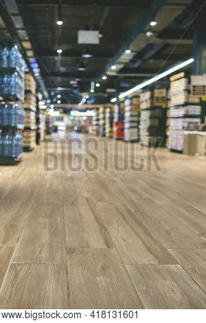 Blurred Image Of Soda And Cracker/chips Aisle In Store. Wide Perspective View Of Empty Store Aisle A
