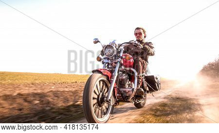 Young Curly Biker With Red Glasses Drive Ride On Red Chopper