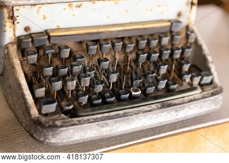 Old And Rusty Type Writer