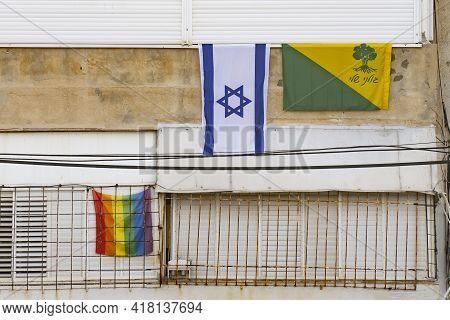 Tel Aviv, Israel - April 16th, 2021: Three Flags On An Old Building In Tel Aviv: The Israeli Nationa