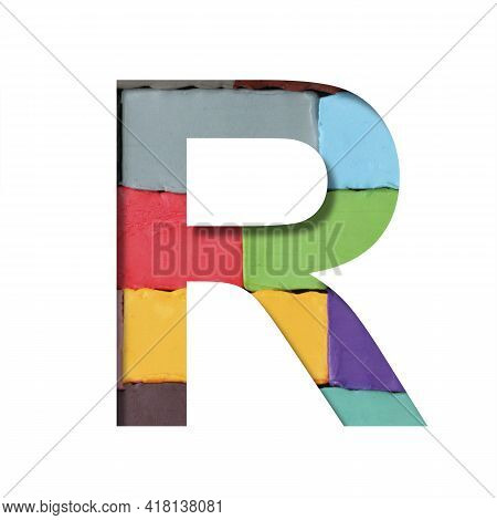 Multi-colored Plasticine Font. Letter R Cut Out Of Paper On A Background Of Pieces Of Colored Plasti