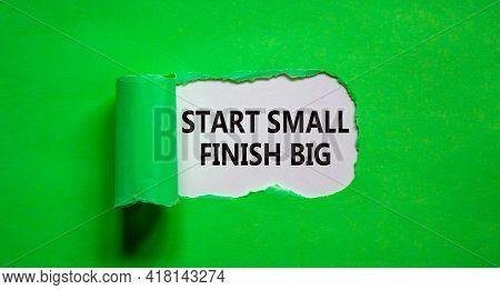 Start Small Finish Big Symbol. Concept Words 'start Small Finish Big' Appearing Behind Torn Green Pa