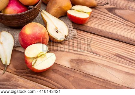 Bowl With Apples And Pears On Wooden Table. Fruit Harvest. Healthy Eating.
