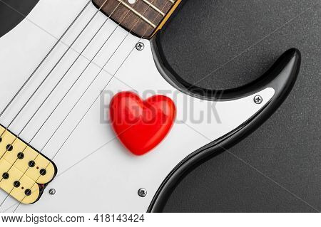 Red Heart On Electric Guitar. Loving Music.