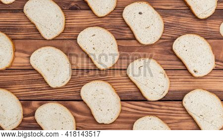 Background Of Sliced Bread On Wooden Background. Top View.