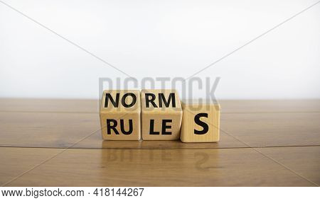 Rules Or Norms Symbol. Turned Cubes And Changed The Word 'norms' To 'rules'. Beautiful Wooden Table,