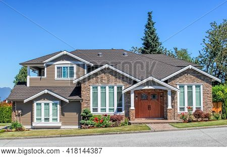 Luxury Residential House With Landscaped Front Yard And Pawed Pathway Over It