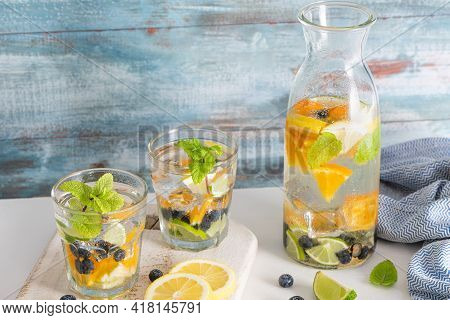 Summer Healthy Cocktails Of Citrus Infused Waters, Lemonades Or Mojitos, With Lime Lemon Orange Blue