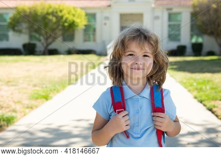 Portrait Of Happy School Kid Is Going To School For The First Time. Child Boy With Bag Go To Element
