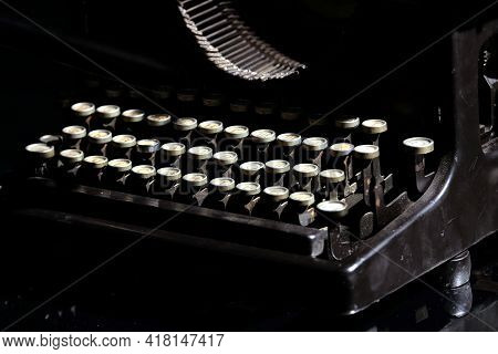 Vintage Mechanical Typewriter With Cyrillic, Keyboard Layout Isolated On Black Background Concept Ph