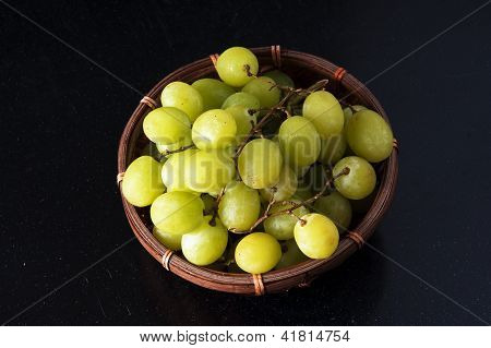 green grapes in a basket