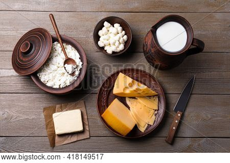 Flat Lay Composition With Dairy Products And Clay Dishware On Grey Wooden Table