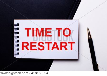 The Words Time To Restarts Written In Red On A Black And White Background Near The Pen