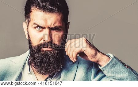 Portrait Of Handsome Bearded Man In Suit. Male Beard And Mustache. Sexy Male, Brutal Macho, Hipster.
