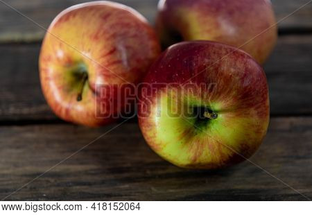 Fresh Apple Of The Gala Variety On Wooden Background