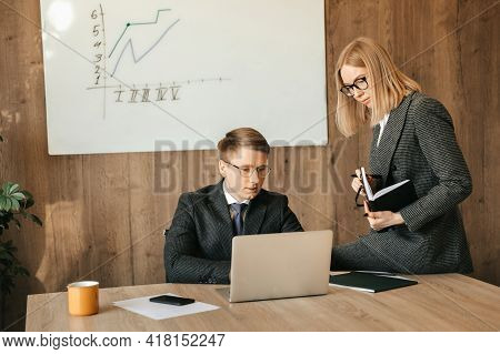 Joyful Successful Colleagues Are Doing Some Paperwork In A Modern Office, Looking At Financial Proje